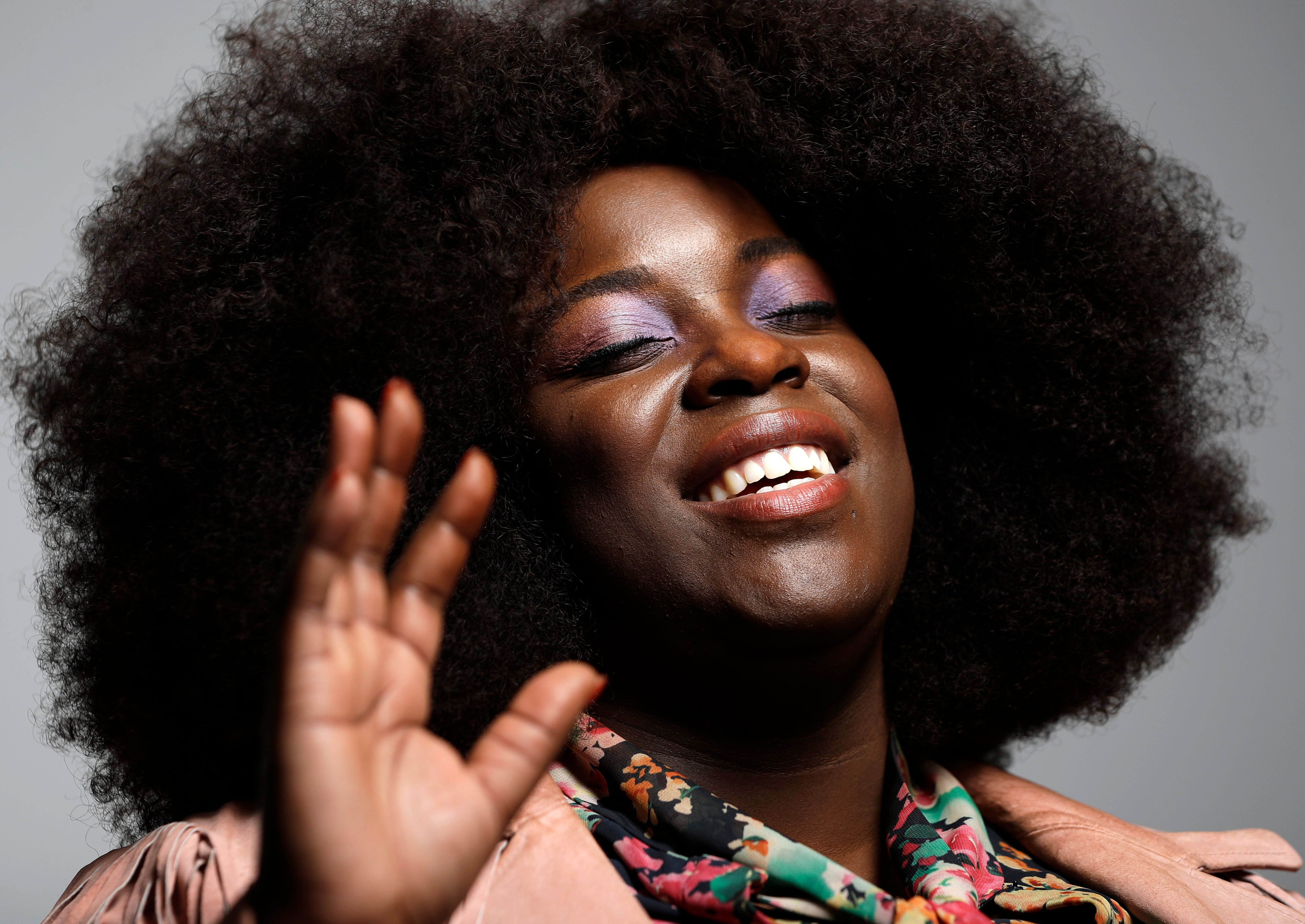 """This Feb. 21, 2019, photo shows British singer-songwriter Yola in Nashville, Tenn. Yola's new album, """"Walk Through Fire,"""" is an exploration of the intersection of soul, country and rock combined with her background in songwriting. Produced and co-written with Black Keys' Dan Auerbach, the record is an introduction to an artist who has spent most of her career behind the scenes as a songwriter or singing in bands."""