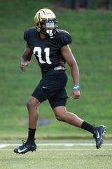 Vanderbilt defensive back Cam Watkins (31) runs drills during practice Monday.