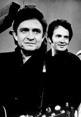 "Johnny Cash performed at San Quentin Prison in 1959, a show attended by Merle Haggard, who was serving a two-year sentence at the time. Here, Cash, left, and Haggard appear together on ""The Glen Campbell Goodtime Hour"" in this undated publicity photo."