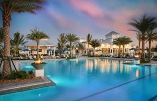 An elegant Clubhouse anchors Greyhawk's resort-style amenities, including a pool with lap lanes, spa and lounge area, sports courts and event lawn.