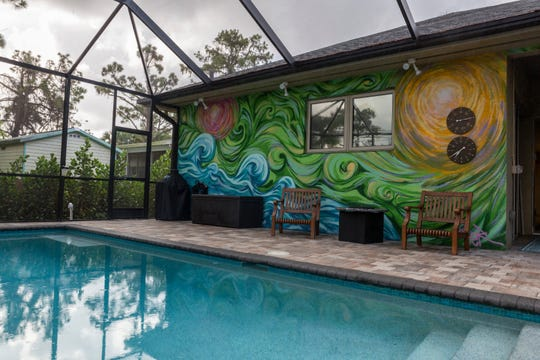 "A mural based on Van Gogh's ""Starry Night"" brings some personality to a lanai in the Bayshore Arts District in East Naples."