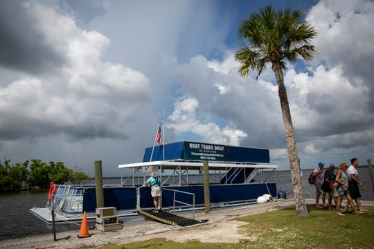 Tour attendees leave the boat after the Ten-Thousand Islands Boat Tour through Everglades National Park in Everglades City on Tuesday, August 6, 2019. Tours are held four times a day, seven days a week, and are dependent on weather.