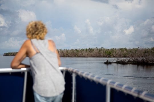 Gereda Besson, of France, looks out over the mangroves during the Ten-Thousand Islands Boat Tour through Everglades National Park in Everglades City on Tuesday, August 6, 2019. The 90-minute tour takes guests across Chokoloskee Bay and into Indian Key Pass.