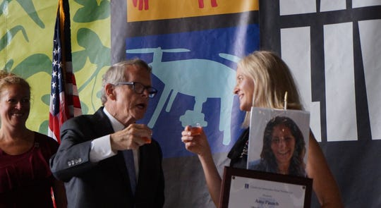 Food Innovator Amy Pausch meets with Ohio Governor Mike DeWine at the Ohio State Fair on July 30 after being announced as the winner.