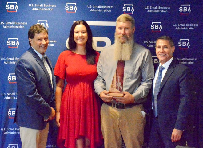 From left, U.S. Rep. Troy Balderson, R-Zanesville, Cynthia Anderson, Dr. Foster Anderson and Small Business Administration District Director Everett Woodel. The Andersons received the SBA Spark Award for sparking economic development.