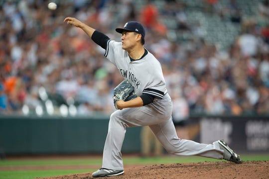 New York Yankees starting pitcher Masahiro Tanaka (19) delivers a pitch in the second inning against the Baltimore Orioles at Oriole Park at Camden Yards.