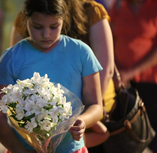 Residents gather in downtown Las Cruces on Monday, Aug. 5, 2019, to mourn the victims of the Aug. 3 deadly shooting in El Paso.