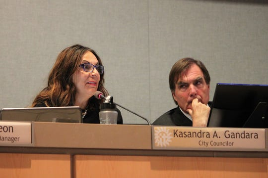 District 1 city Councilor Kasandra Gandara reacts to information on the El Paso massacre as District 2 city Councilor Greg Smith looks on during the Las Cruces City Council meeting on Monday, Aug. 5, 2019.
