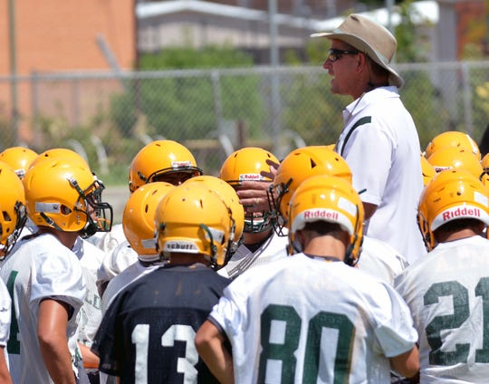 Mayfield High head coach Mike Bradley speaks to his players on the first day of practice for this coming season.  Photo taken 8/5/19.