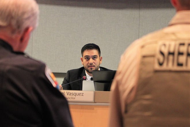 Las Cruces City Councilor Gabriel Vasquez, center, speaks to Las Cruces Police Chief Patrick Gallagher and Doña Ana County Undersheriff Jaime Quezada about Operation Stonegarden during the council meeting on Monday, August 5, 2019.