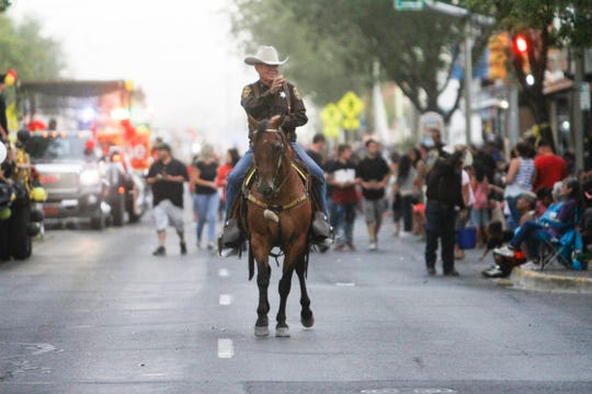 San Juan County Sheriff's Posse Capt. Dave Williams participates, Friday, Aug. 10, 2018 in the San Juan County Fair Parade on Main Street in Farmington.