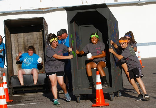 Pioneer Adultz 4-H and members of Bloomfield FFA race against each other, Monday, Aug. 8, 2016 during the San Juan County Fair Outhouse Race at McGee Park in Farmington.