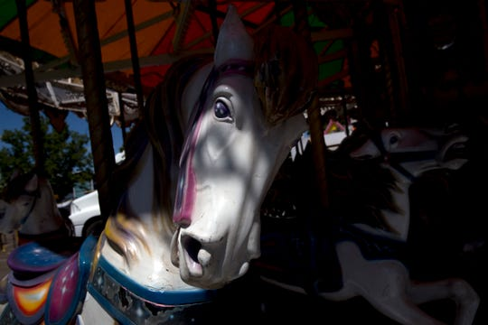 A carousel is pictured, Thursday, Aug. 10, 2017 at McGee Park in Farmington.