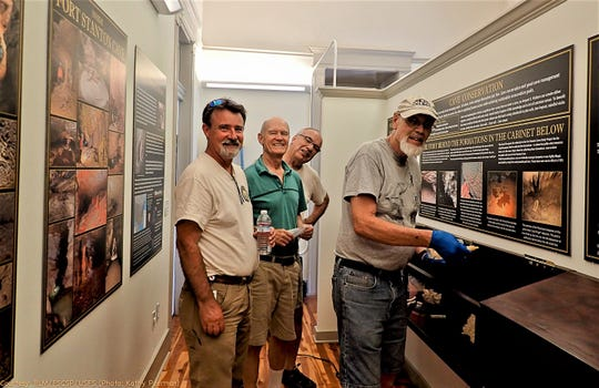 From left, Knutt Peterson, Ron Lipinski, Sam Bono and Steve Peerman finish one of the exhibit areas.