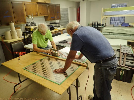 Pete Lindsley and Wayne Walker cut glass for the museum cave display.