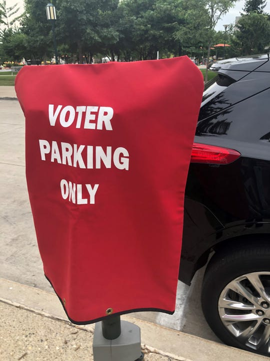 A parking meter is covered in the city of Birmingham Aug. 6, 2019 as a courtesy to those voting on a parking structure proposal.