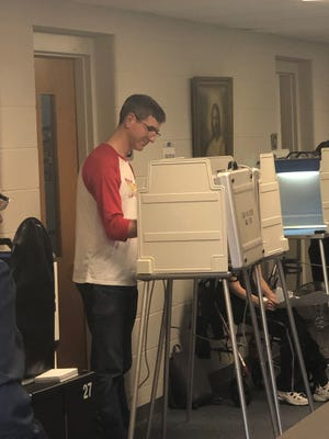 Matthew Welch votes on the Bloomfield Township S.A.D. proposal at St. Paul Methodist Church on Aug. 6, 2019.