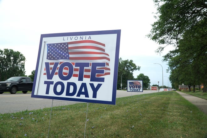 Signs along Middlebelt Road near Clarenceville High indicate voting precincts on Aug. 6.