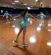 Members of Canton's Skatin' Station Artistic Club hit the floor on Aug. 6.