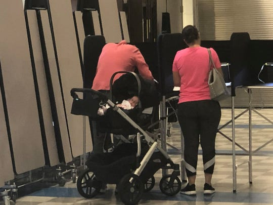 Voters, and possibly a future voter, at Pierce Elementary in Birmingham on Tuesday, Aug. 6, 2019.