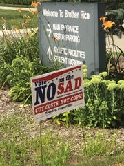 A sign outside Brother Rice urges voters to oppose the S.A.D. proposal in Bloomfield Township.