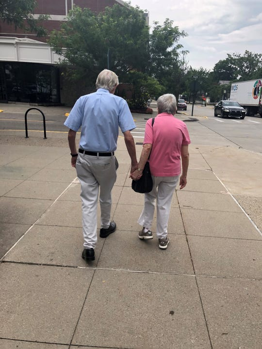 Jane and Bob Eberwein leave the municipal building in downtown Birmingham after voting on Tuesday. The couple has been married for 48 years, and have lived in the city all of that time.