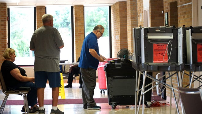 Voters wait to cast their ballots at Clarenceville Junior High on Aug. 6.