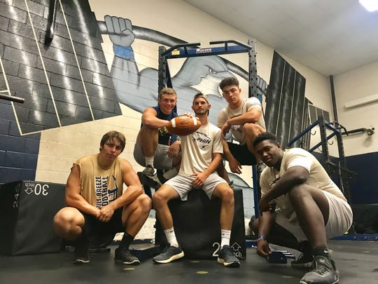 Gulf Breeze seniors (L to R) Joel Gaston, Sam Sharp, Trey Alexander, Trever Nelsen and Tyrese Smith are key ingredients to a reloaded Dolphin team.