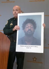 Santa Rosa County Sheriff Bob Johnson announces the arrest of Travis Montes Mitchell during a press conference on Tuesday, Aug. 6, 2019. Mitchell was arrested following a traffic stop and is facing a variety of charges including weapon and drug violations.  Mitchell, who is 33,  has a criminal record more than 40 pages long, Johnson said.