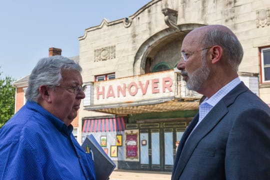 Pennsylvania Gov. Tom Wolf talks across the street from the old Hanover Theater on Frederick Street during a tour of downtown Hanover on Tuesday, August 6, 2019.