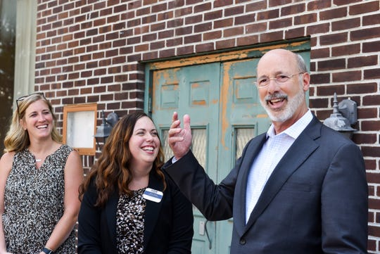 Pennsylvania Gov. Tom Wolf speaks outside the old Montgomery Ward building on Frederick Street during a tour of downtown Hanover on Tuesday, August 6, 2019.