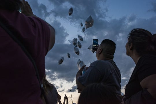 Thousands of mourners contribute candles, notes, flowers, and prayer to the spreading memorial at the Cielo Vista Walmart on Aug. 5, 2019, two days after the deadly attack in El Paso, Texas.