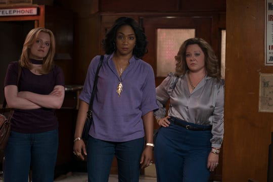 """Elisabeth Moss (from left), Tiffany Haddish and Melissa McCarthy star in """"The Kitchen."""""""