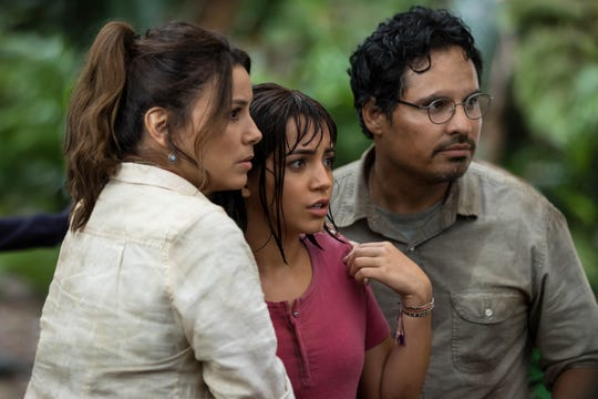 "Dora (Isabela Moner) is surrounded by parents (Eva Longoria and Michael Peña) in ""Dora and the Lost City of Gold."""