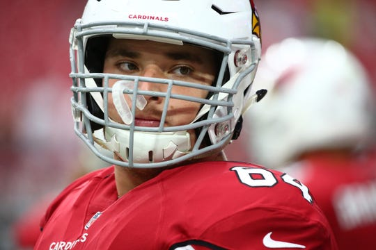 Mason Cole started at center as a rookie for the Cardinals because of injuries.