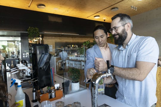 Dan Suh (left) and Lawrence Jarvey, owners of Provision Coffee Bar, located at 4501 N. 32nd St. in Phoenix.