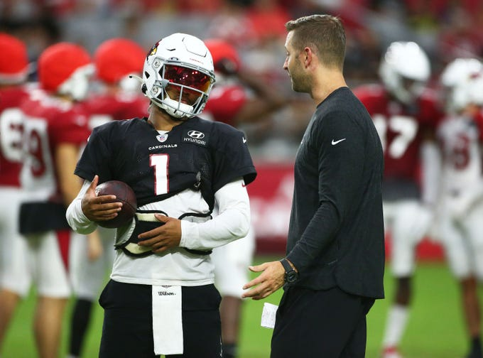 Arizona Cardinals quarterback Kyler Murray (1) talks to head coach Kliff Kingsbury during training camp on Aug. 6, 2019 in Glendale, Ariz.