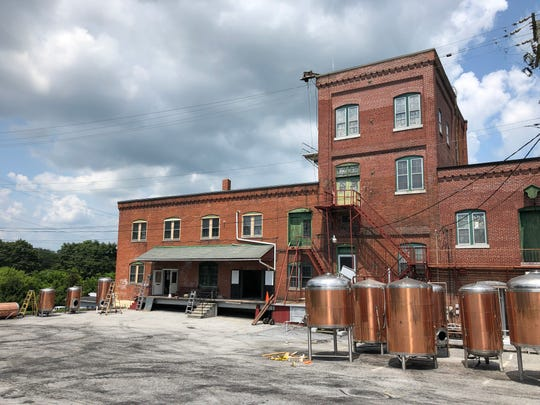 Large tanks sit outside the historic Lebanon Brewery, which will soon be to Lebanon Valley Brewing Company.
