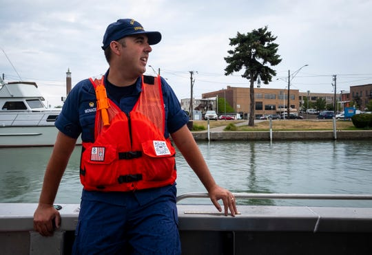 U.S. Coast Guard Lt. Cmdr. Nick Monacelli talks about conditions of the Black River while patrolling aboard one of USCGC Hollyhock's Aids to Navigation boats Tuesday, Aug. 6, 2019, in Port Huron.