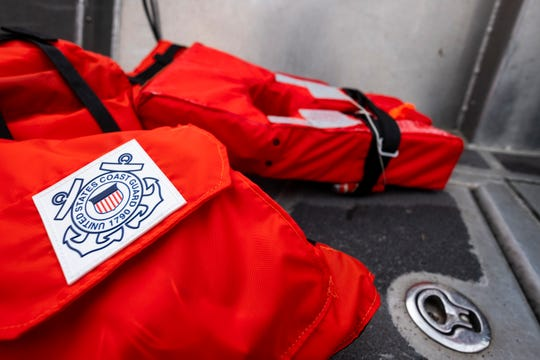 A stack of spare life jackets are stored in the passenger space aboard one of USCGC Hollyhock's Aids to Navigation boats. The U.S. Coast Guard has decided to back away from the tradition type rating system and is instead requiring life jacket labels to have images depicting what kind of conditions and activities it is suitable for.