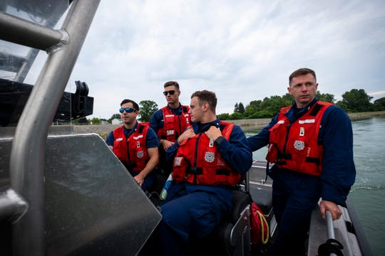 Several crewmembers from USCGC Hollyhock patroll the Black River in one of the ship's Aids to Navigation boats Tuesday, Aug. 6, 2019, in Port Huron.