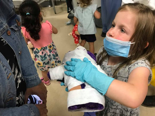 Emily Mann (right) shows her mother Liz (left) her Care Bear Sprinkles after she has been medically wrapped up as part of MidHudson Regional's teddy bear clinic on Tuesday, Aug. 6, 2019.
