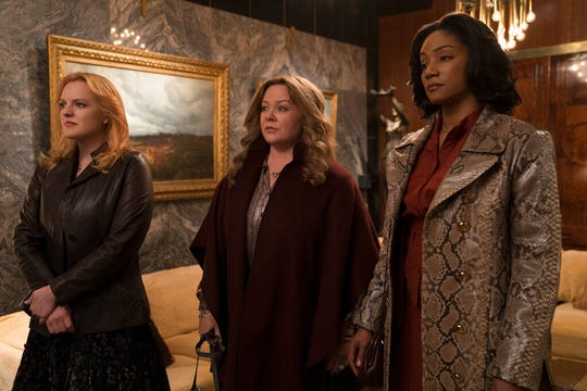 "From left, Elisabeth Moss, Melissa McCarthy and Tiffany Haddish star in ""The Kitchen."" The movie opens Friday at Regal West Manchester, Frank Theatres Queensgate Stadium 13 and R/C Hanover Movies."