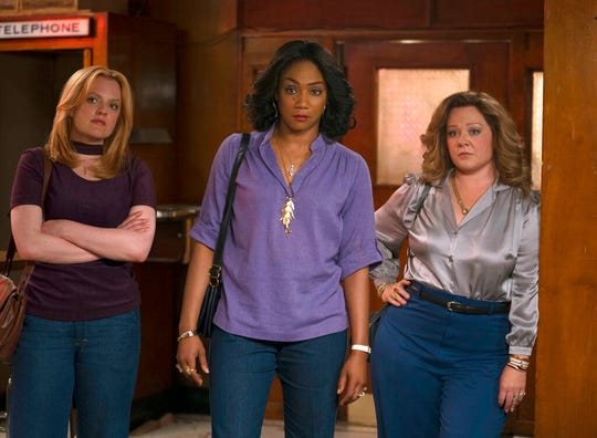 "From left, Elisabeth Moss, Tiffany Haddish and Melissa McCarthy star in ""The Kitchen."" The movie opens Friday at Regal West Manchester, Frank Theatres Queensgate Stadium 13 and R/C Hanover Movies."