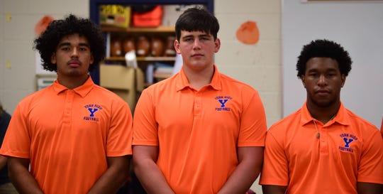 York High players William Molina, Trey Bernstein and Aaron Johnson pose for a photo in the locker room at Smalls Field on Tuesday, August 6.