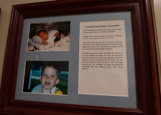 Photographs and a bio of Christian Cooper hang on the 'Wall of Hope' outside the NICU at York Hospital. Cooper and his twin brother Ian were both born premature.