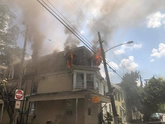 Firefighters battle a blaze on North Queen Street in York on Tuesday.