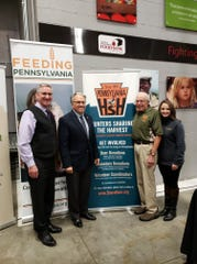 Secretary, Pa. Dept of Agriculture, Russell Redding (far left), Chair of the Pa. Sportsmen's Caucus, Rep. Eddie Day Pashinski (second from left),  Executive Director of Hunters Sharing the Harvest, John Plowman (second from right) and Exec. Director Feeding Pa. Jane Clements-Smith (far right) at a 2018 event urging hunters to donate excess deer.