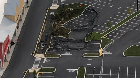 This photo of the Tanger Outlets sinkhole in August 2018, taken by the U.S. Hot Air Balloon Team, shows the original size of the sink.