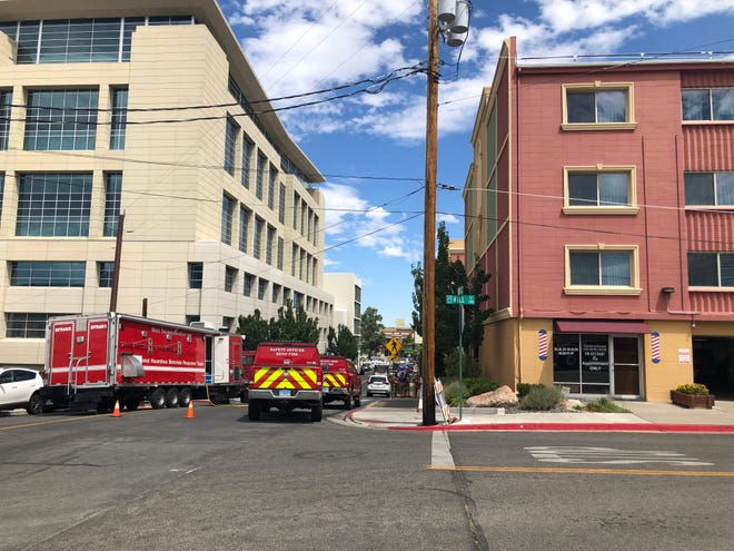 Emergency response vehicles respond to a hazardous materials call at Court Street on Tuesday, Aug. 6.